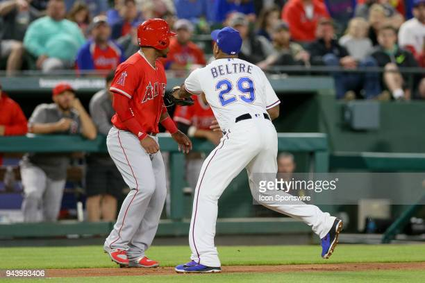 Texas Rangers Third base Adrian Beltre tags Los Angeles Angels Infield Luis Valbuena out during the game between the Los Angeles Angels and Texas...