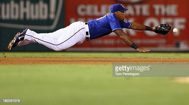 Texas Rangers third baseman Adrian Beltre dives for a ground ball hit by Pittsburgh Pirates right fielder Marlon Byrd in the top of the fifth innin...