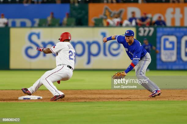 Texas Rangers third baseman Adrian Beltre rounds around a tag from Toronto Blue Jays shortstop Troy Tulowitzki during the MLB game between the...