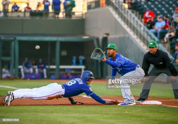 Texas Rangers third baseman Drew Robinson dives to first base during the MLB Spring Training baseball game between the Kansas City Royals and the...