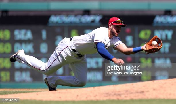 Texas Rangers third baseman Joey Gallo dives for a ball hit by Kansas City Royals Whit Merrifield in the fifth inning on Sunday April 23 2017 at...