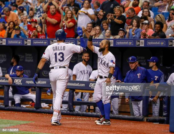Texas Rangers third baseman Joey Gallo is congratulated by second baseman Rougned Odor after scoring during the game against the Houston Astros at...
