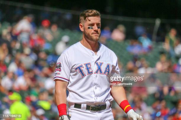 Texas Rangers third baseman Patrick Wisdom walks off after striking out during the game between the Oakland Athletics and Texas Rangers on April 14...