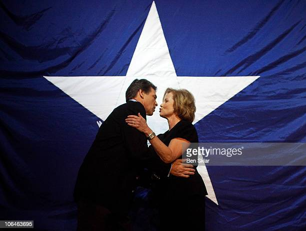 Texas Republican Gov Rick Perry embraces his wife Anita at the Victory Texas and Republican Party of Texas election night watch party at the Texas...