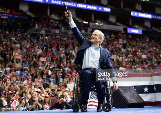 Texas Republican Governor Greg Abbott speaks during a campaign rally by US President Donald Trump at the Toyota Center in Houston Texas October 22...
