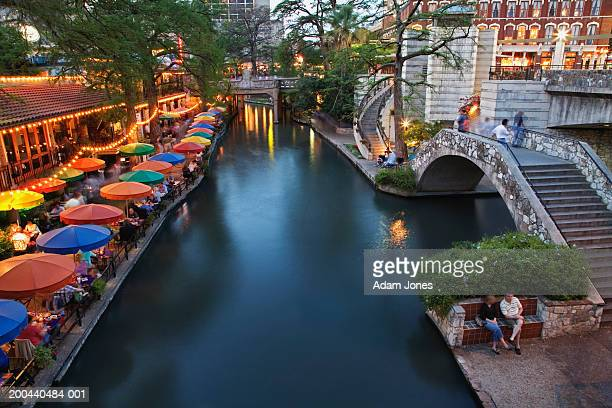 usa, texas, san antonio, san antonio river and river walk at dusk - san antonio texas stock photos and pictures
