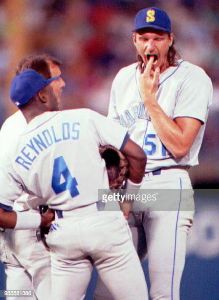 Seattle Mariners pitcher Randy Johnson winces as he checks his dental work during the second inning of the Mariners' game with the Texas Rangers 11...