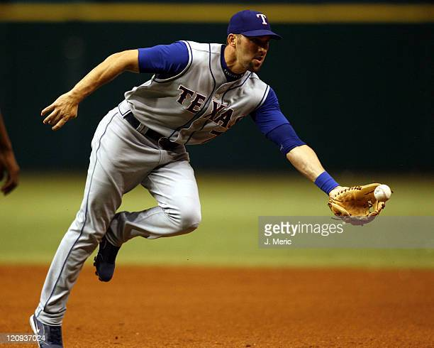 Texas second baseman, Mark DeRosa tries to make a play on this ball during Tuesday night's action against Tampa Bay at Tropicana Field in St....
