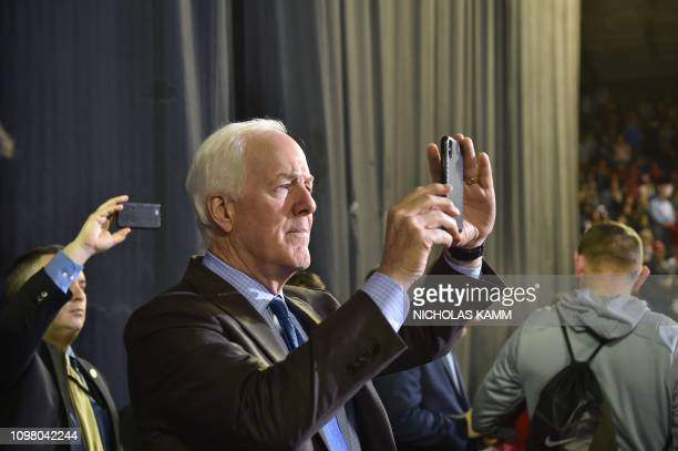 US Texas senator John Cornyn takes a picture during a US President Donald Trump rally in El Paso Texas on February 11 2019