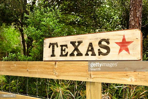 Texas sign with star on fence