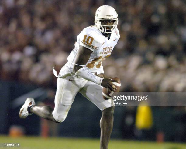 Texas sophomore quarterback Vince Young scores on a 10yard touchdown run in the fourth quarter of 3837 victory over Michigan in the 91st Rose Bowl in...
