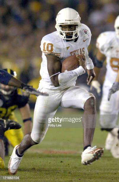 Texas sophomore quarterback Vince Young scrambles during the fourth quarter of 3837 victory over Michigan in the 91st Rose Bowl in Pasadena Calif on...