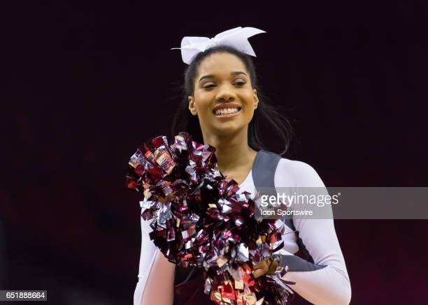 Texas Southern cheerleader greets the fans during the SWAC basketball tournament game between the Texas Southern Tigers and Grambling State Tigers on...