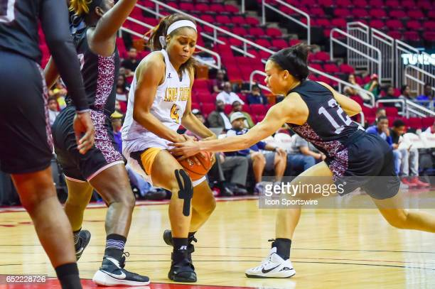 Texas Southern Lady Tigers guard Chynna Ewing reaches in on Grambling State Tigers guard Monisha Neal during the SWAC Basketball Tournament...