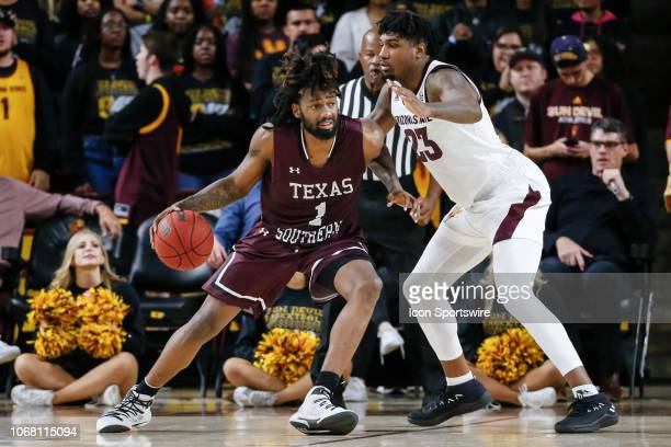 Texas Southern Tigers forward Jeremy Combs dribbles the ball defended by Arizona State Sun Devils forward Romello White during the college basketball...