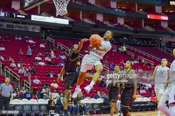 Texas Southern Tigers guard Demontrae Jefferson drives on Grambling Tigers guard Ervin Mitchell during the SWAC Basketball Tournament game between...