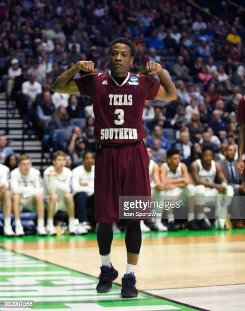 Texas Southern Tigers guard Demontrae Jefferson flexes his muscles to the camera after getting fouled and scoring the basket against the Xavier...