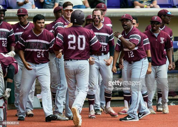 Texas Southern Tigers outfielder Christian Sanchez scores a run during a NCAA Baton Rouge Regional game between the LSU Tigers and Texas Southern...