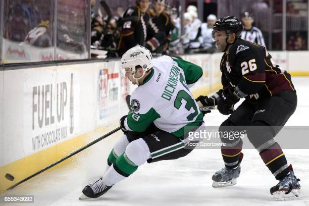 Texas Stars C Jason Dickinson plays the puck along the boards as Cleveland Monsters D Jaime Sifers defends during the second period of the AHL hockey...