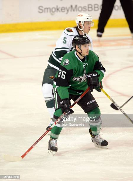 Texas Stars center Mark McNeill defends Iowa Wild center A J Jenks during minor league hockey game between the Iowa Wild and the Texas Stars on March...