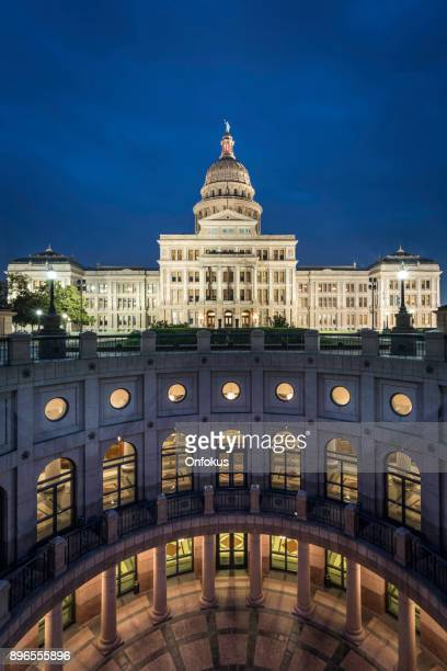 texas state capitol building in austin illuminated at sunrise - austin texas stock pictures, royalty-free photos & images