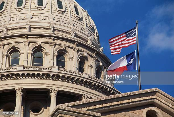 texas state capitol dome and flags - texas stock pictures, royalty-free photos & images