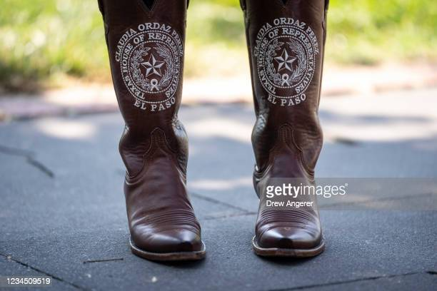 Texas State Rep. Claudia Ordaz Perez wears personalized boots during a news conference about voting rights outside the U.S. Capitol on August 6, 2021...