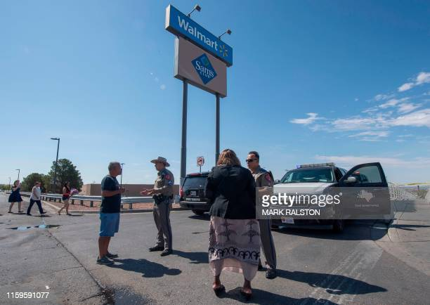Texas State Troopers block the entrance to the Cielo Vista Mall WalMart where a shooting left 20 people dead in El Paso Texas on August 4 2019 Texas...