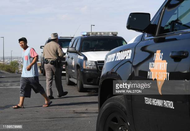 Texas State Troopers keep watch outside the Cielo Vista Mall WalMart where a shooting left 20 people dead in El Paso Texas on August 4 2019 Texas...