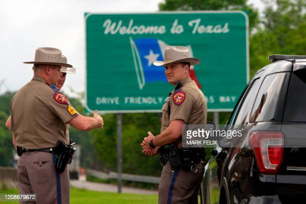 Texas State troopers patrol I10 across the border from Louisiana on March 30 2020 in Orange Texas Texas governor Greg Abbott expanded an executive...