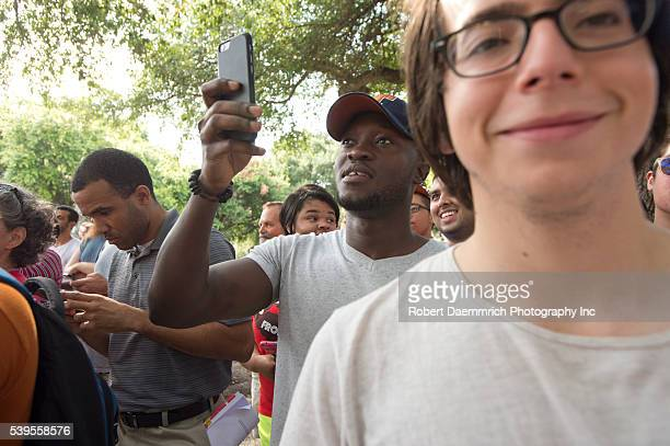 Texas students watch as a 1933 statue of Confederate leader Jefferson Davis is removed from University of Texas' South Mall Sunday after UT President...