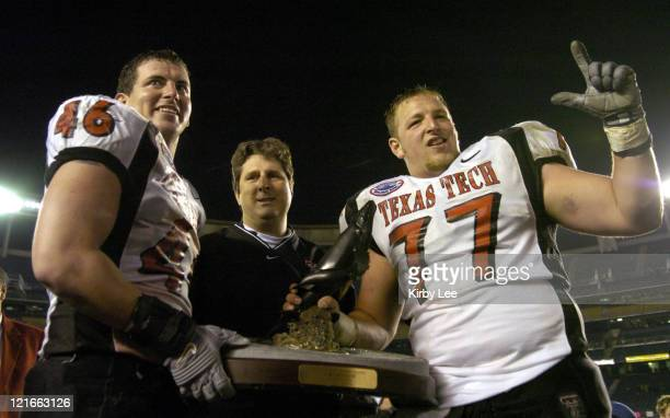 Texas Tech coach Mike Leach holds Pacific Life Holiday Bowl trophy with Mike Smith and Dylan Gandy after 4531 victory over Cal in the Pacific Life...