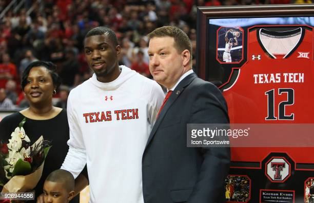 Texas Tech guard Keenan Evans poses with head coach Chris Beard during the senior day ceremonies prior to the No12 Texas Tech Raider's 7975 victory...