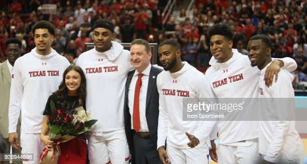 Texas Tech head coach Chris Beard poses with the seniors during the senior day ceremonies prior to the No12 Texas Tech Raider's 7975 victory over the...