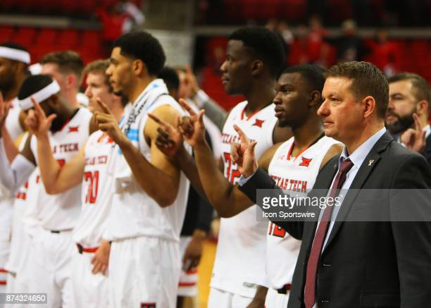 Texas Tech head coach Chris Beard stands for the school song with the team after the Texas Tech Raider's 8344 victory over the Maine Black Bears on...