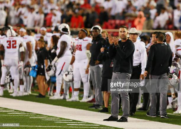 Texas Tech head coach Kliff Kingsbury applauds as the final seconds tick off the clock during the Texas Tech Raider's 5245 victory over the Arizona...