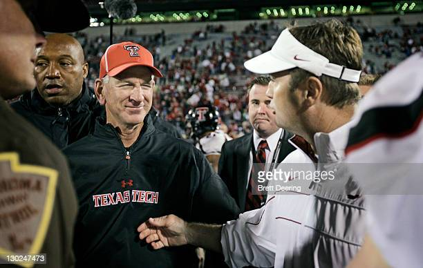 Texas Tech Head Coach Tommy Tuberville and the Oklahoma Sooners Head Coach Bob Stoops meet after the game October 22, 2011 at Gaylord Family-Oklahoma...