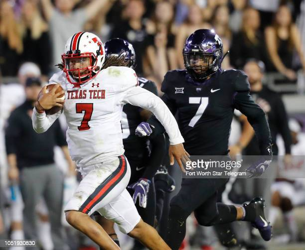 Texas Tech quarterback Jett Duffey left outruns TCU linebacker Arico Evans right and safety La'Kendrick Van Zandt for the winning score covering 38...