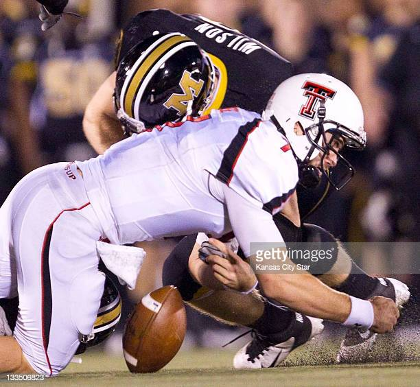 Texas Tech quarterback Seth Doege had his knee down as Missouri linebacker Andrew Wilson delivers a blow that knocked the ball loose in the fourth...