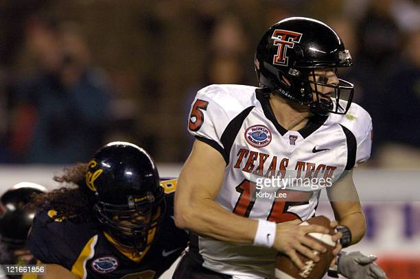 Texas Tech quarterback Sonny Cumbie scrambles under pressure of Cal linebacker Joe Maningo during 4531 victory over Cal in the Pacific Life Holiday...