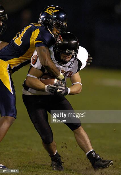 Texas Tech receiver Danny Amendola is tackled by Cal cornerback Harrison Smith in the Pacific Life Holiday Bowl at Qualcomm Stadium in San Diego...
