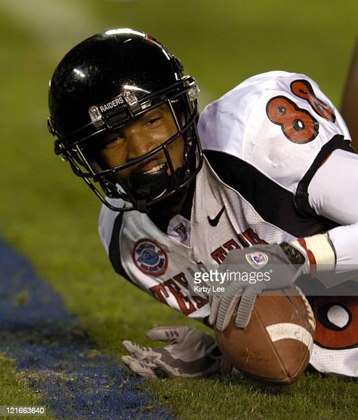 Texas Tech receiver Jarrett Hicks scores on a 9yard reception in the firstquarter touchdown during 4531 victory over Cal in the Pacific Life Holiday...