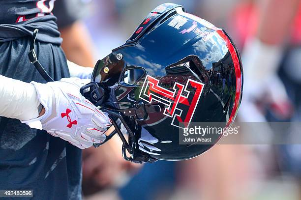 Texas Tech Red Raider player holds a helmet before the game against the Iowa State Cyclones on October 10, 2015 at Jones AT&T Stadium in Lubbock,...