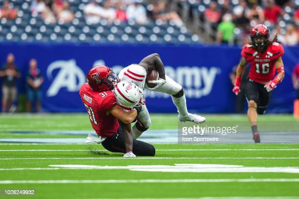 Texas Tech Red Raiders defensive back Justus Parker brings down Mississippi Rebels wide receiver AJ Brown during the AdvoCare Kickoff college...