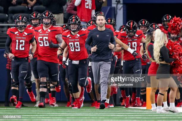 Texas Tech Red Raiders head coach Kliff Kingsbury leads his team out onto the field prior to the TFBI Shootout between the Baylor Bears and Texas...