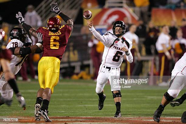 Texas Tech Red Raiders quarterback Graham Harrell unleashe a pass downfield against the Minnesotta Golden Gophers during the Insight Bowl at Sun...