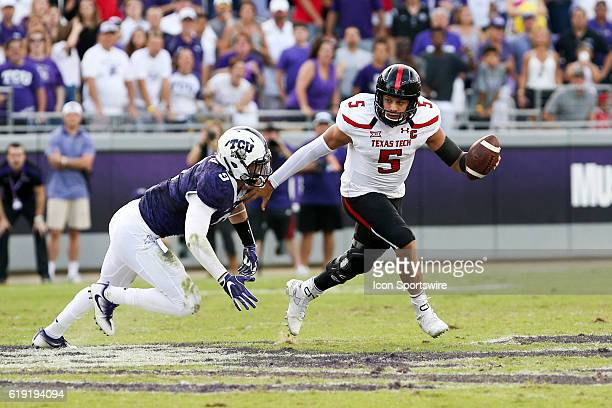 Texas Tech Red Raiders quarterback Patrick Mahomes II is chased by TCU Horned Frogs defensive end Mat Boesen during the NCAA Big12 football game...