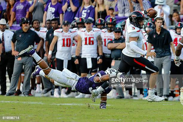Texas Tech Red Raiders quarterback Patrick Mahomes II runs from a diving TCU Horned Frogs defensive end Mat Boesen during the game between the TCU...