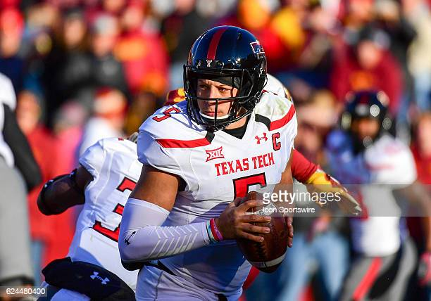Texas Tech Red Raiders quarterback Patrick Mahomes II scrambles as he looks down field for a receiver during the first half of an NCAA football game...