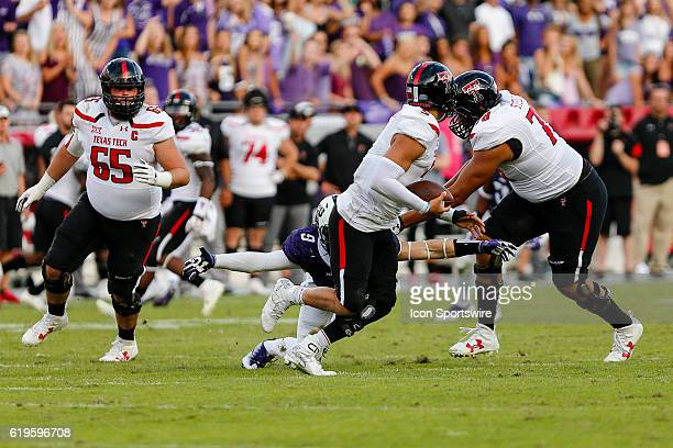 Texas Tech Red Raiders quarterback Patrick Mahomes II tries to escape from the outstretched arms of TCU Horned Frogs defensive end Mat Boesen during...